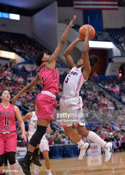 UConn Huskies Guard Crystal Dangerfield shoots over Wichita State Shockers Guard Keke Thompson during the game as the UConn Huskies host the Wichita...