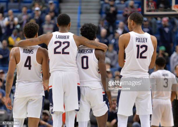UConn Huskies Guard / Forward Terry Larrier huddle with teammates as UConn Huskies Guard Alterique Gilbert shoots a free throw during the game as the...