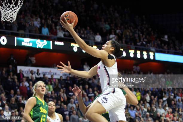 UConn Huskies guard Gabby Williams drives to the basket during the first half of the American Athletic Conference Women's championship game between...