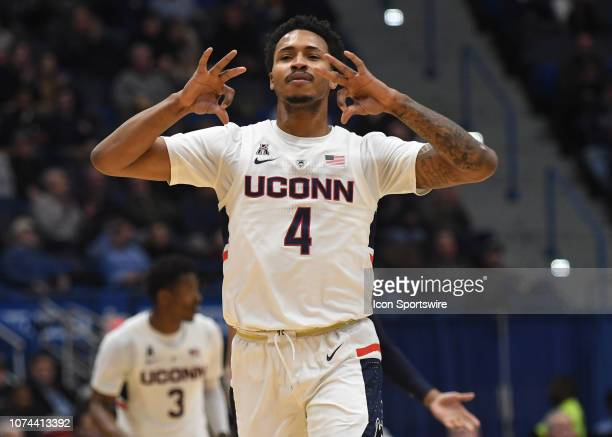 UConn Huskies guard Jalen Adams makes the three point gesture after scoring during the game as the Drexel Dragons take on the UConn Huskies on...