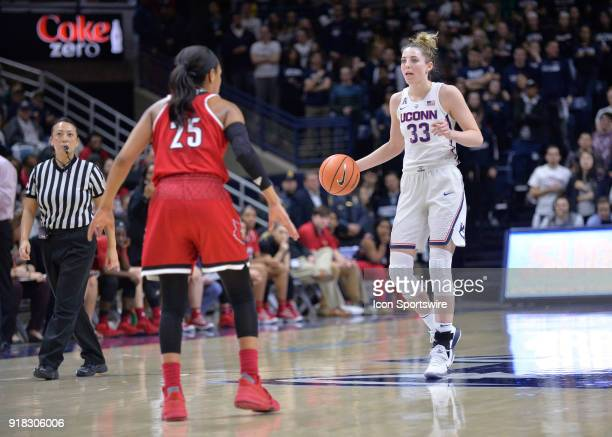 UConn Huskies Guard Katie Lou Samuelson brings the ball up the court while Louisville Cardinals Guard Asia Durr defends during the game as the UConn...