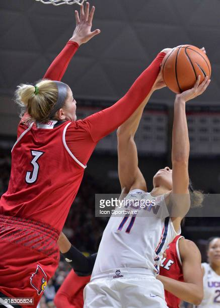 UConn Huskies Guard Kia Nurse has he shot blocked by Louisville Cardinals Forward Sam Fuehring during the game as the UConn Huskies host the...