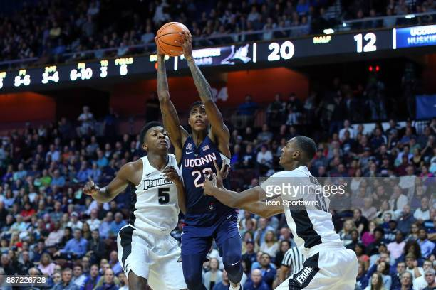 UConn Huskies guard Terry Larrier drives to the basket defended by Providence Friars forward Rodney Bullock and Providence Friars center Dajour...