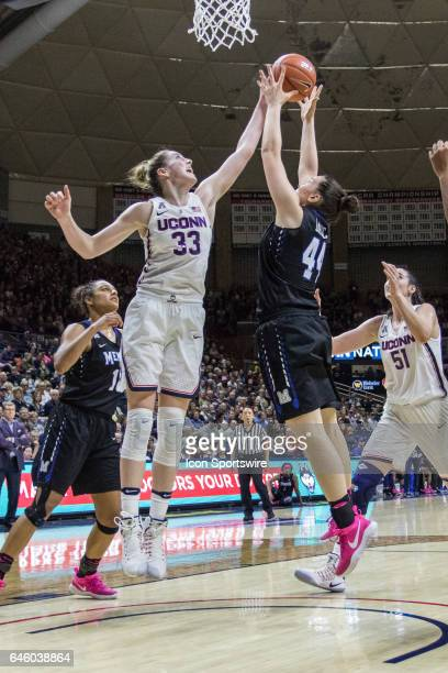 UConn Huskies Guard/Forward Katie Lou Samuelson and Memphis' Forward Milena Bajic reach out from a rebound during the first half of a women's...