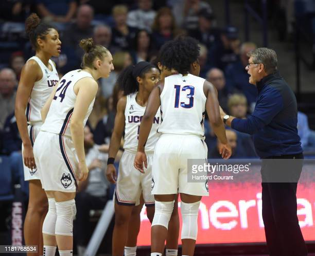 UConn Huskies head coach Geno Auriemma, far right, speaks to his players at a break in the action against California at Gampel Pavilion Sunday...