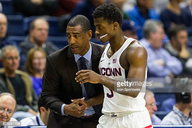 UConn Huskies Head Coach Kevin Ollie talks with UConn Huskies Guard Alterique Gilbert at the bench during the first half of a men's NCAA division 1...