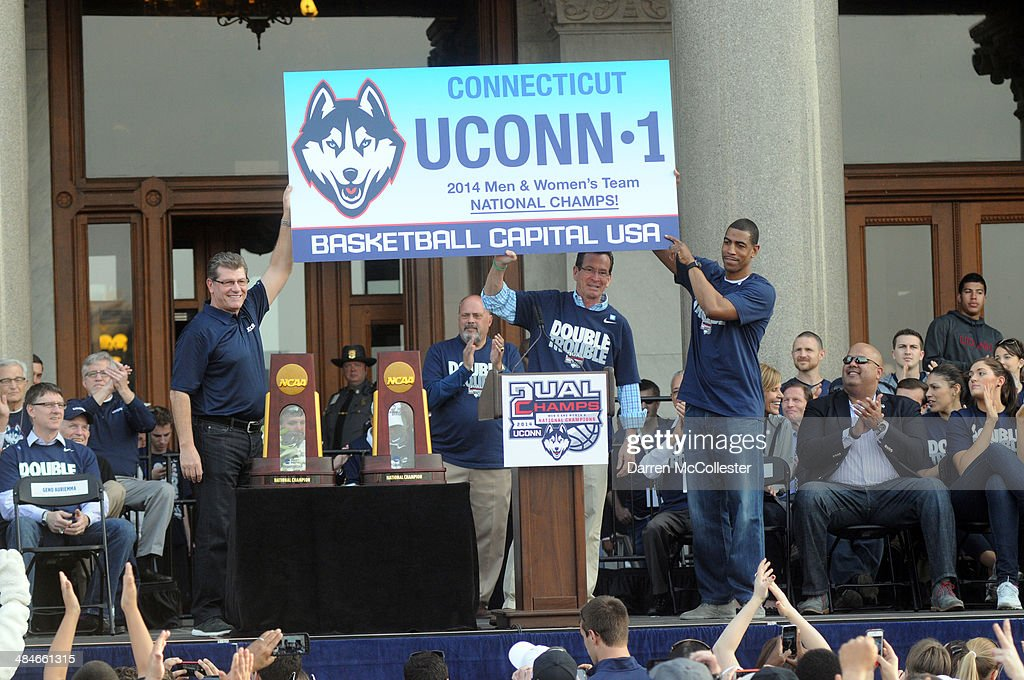 Uconn Huskies men's head coache Kevin Ollie (R) and women's head coach Geno Auriemma attend a rally at the Connecticut State Capitol to celebrate their national championships April 13, 2014 in Hartford, Connecticut. This year was the second time both the men's and women's Uconn basketball teams have won national championships in the same year.