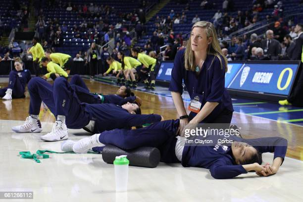 UConn Huskies strength and conditioning coach Amanda Kimball treats Gabby Williams of the Connecticut Huskies during warm up before the UConn Huskies...