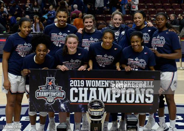 UConn Huskies team holds up the championship banner after the game as the UCF Knights take on the UConn Huskies on March 11 2019 at the Mohegan Sun...