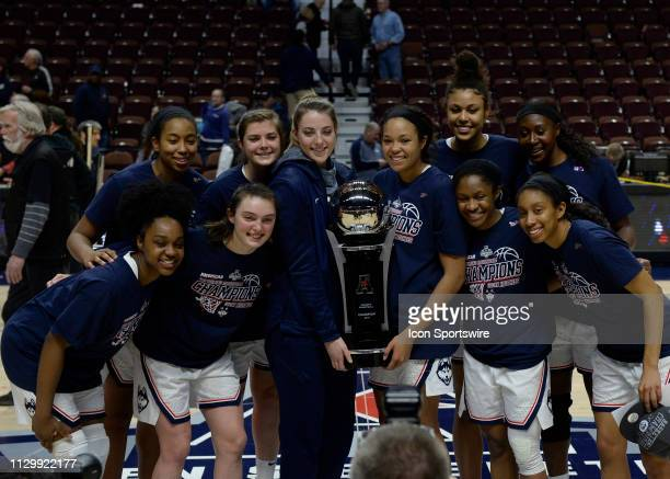 UConn Huskies team with the American Athletic Championship trophy after the game as the UCF Knights take on the UConn Huskies on March 11 2019 at the...