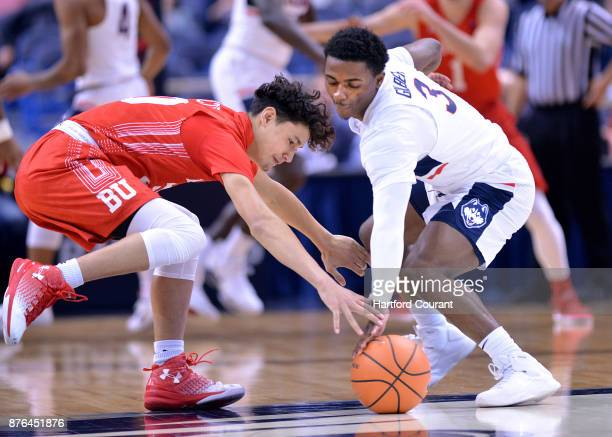 UConn's Alterique Gilbert left battles for a ball with Boston University's Javante McCoy in the first half on Sunday Nov 19 2017 at the at XL Center...
