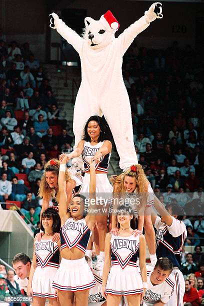 UConn's cheerleaders form a pyramid while leading the crowd in cheers Hartford Connecticut 1994