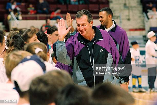 UConn's Jim Calhoun high fives young fans on the sidelines of his basketball clinic, Hartford, Connecticut, 1994.