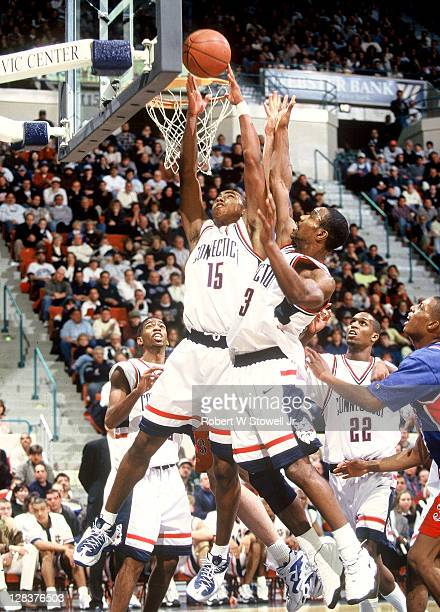 UConn's Kevin Freeman and Rashmel Jones corral a rebound during a game in Hartford CT 1999