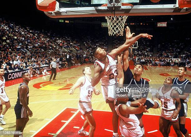 UConn's Lyman DePriest rejects a shot by Georgetown's center Alonzo Mourning during a Big East game in Hartford CT 1991
