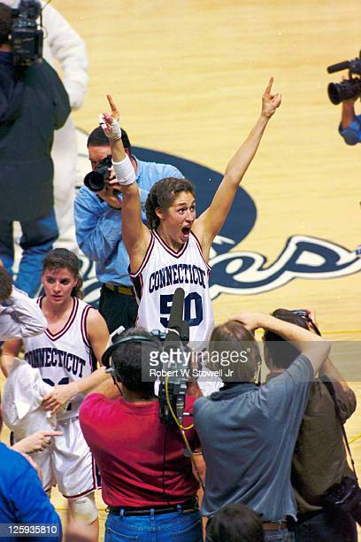 UConn's Rebecca Lobo raises her arms and lets out a joyous shout as she celebrates her team's victory over rival Tennessee Storrs CT 1995