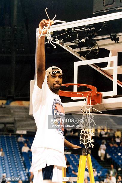 UConn's Richard 'Rip' Hamilton cuts down the nets after defeating Duke to win the 1999 NCAA championship, St. Petersburg Florida, 1999.