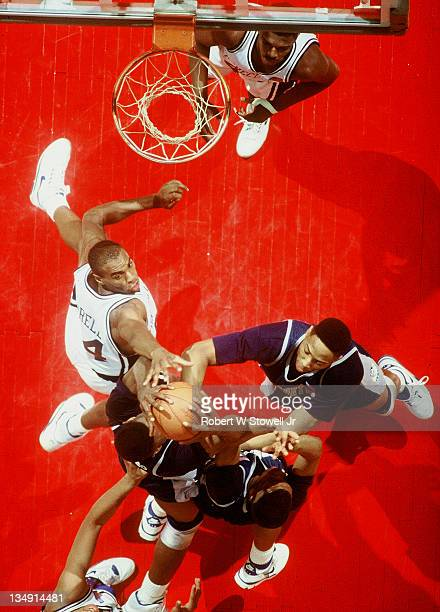 UConn's Scott Burrell, left, contests Georgetown's Alonzo Mourning and Dikembe Mutombo for a rebound, Hartford CT 1991.