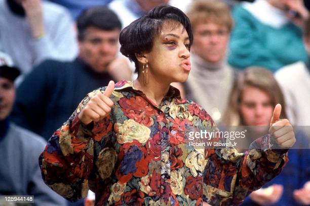 UConn's Tonya Boone of the women's basketball team supports the team from the bench while she recovers from a black eye Storrs CT 1990