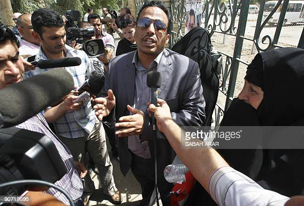Udai the brother of jailed Iraqi television journalist Muntazer alZaidi announces to the press that his brother's imminent release will be delayed as...