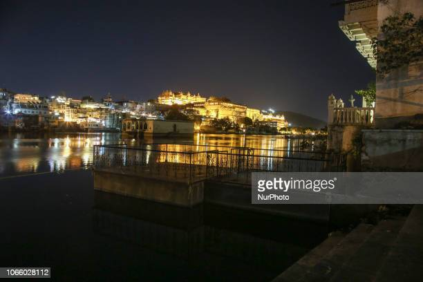 Udaipur's waterfront in the night in India Udaipur or the City of the Lakes in Rajasthan as seen in the night with its illuminated historical...
