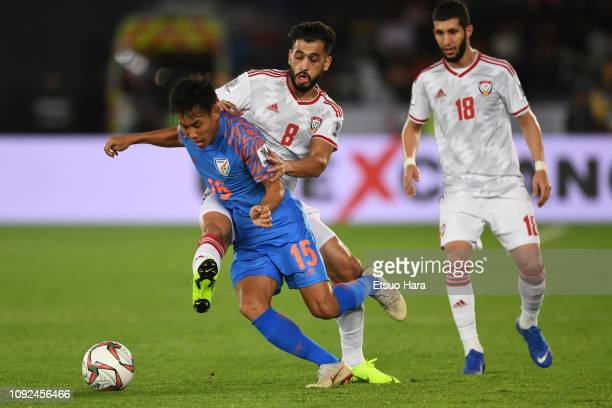 Udanta Singh Kuman of India and Majed Hassan Ahmed of United Arab Emirates compete for the ball during the AFC Asian Cup Group A match between India...