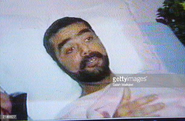 PHOTO Uday Saddam Hussein son of Iraqi President Saddam Hussein lies in a hospital in this undated photo from Jordanian television Uday and his...
