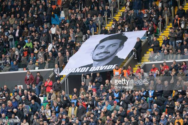 Udinese and Fiorentina fans shows a banner to remember Davide Astori during the serie A match between Udinese Calcio and ACF Fiorentina at Stadio...