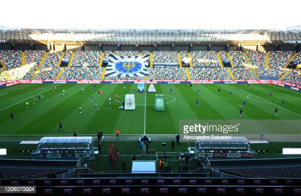 Udinese Calcio and ACF Fiorentina players warm-up in the empty stadium after rules to limit the spread of Covid-19 were been put in place and meant...