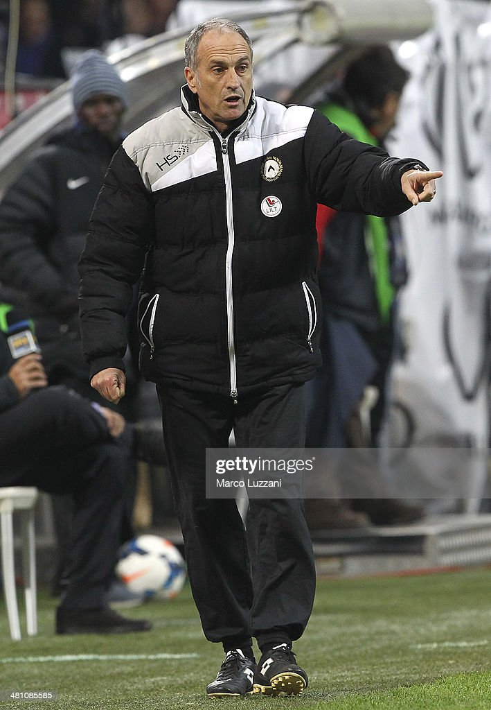 Udinese Calcio coach Francesco Guidolin issues instructions to his players during the Serie A match between FC Internazionale Milano and Udinese Calcio at San Siro Stadium on March 27, 2014 in Milan, Italy.