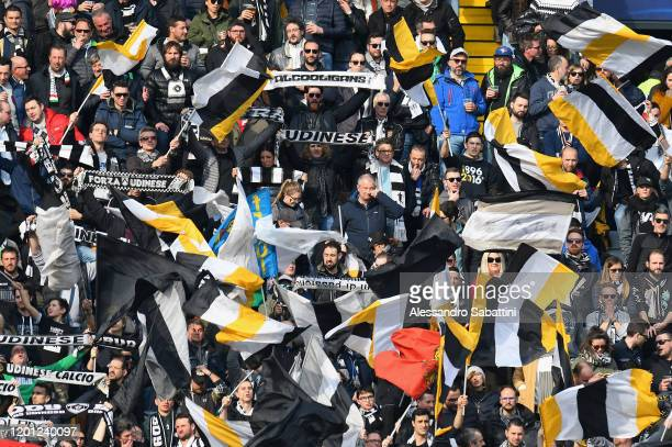 Udinese Calcio fans show their support during the Serie A match between Udinese Calcio and Hellas Verona at Stadio Friuli on February 16 2020 in...