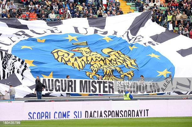 Udinese fans hold up a banner wishing Head coach of Udinese Francesco Guidolin a happy birthday during the Serie A match between Udinese Calcio and...