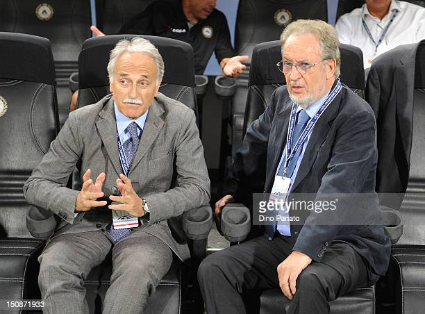 Udinese President Gianpaolo Pozzo and DS Francesco Larini look on before the UEFA Champions League play-off match between Udinese Calcio and SC Braga...