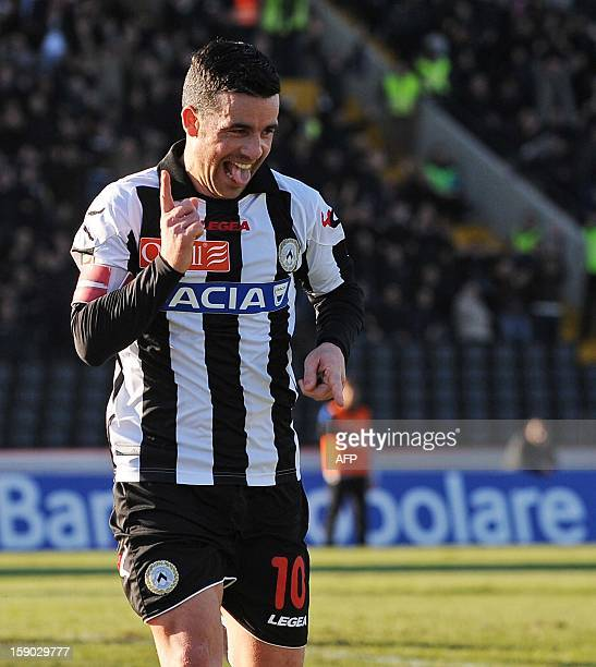 Udinese's Antonio Di Natale celebrates after scoring the third goal during the Italian Serie A football match between Udinese and Inter Milan on...