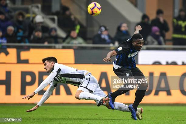 Udinese's Argentine forward Ignacio Pussetto and Inter Milan's Ghanaian midfielder Kwadwo Asamoah go for the ball during the Italian Serie A football...