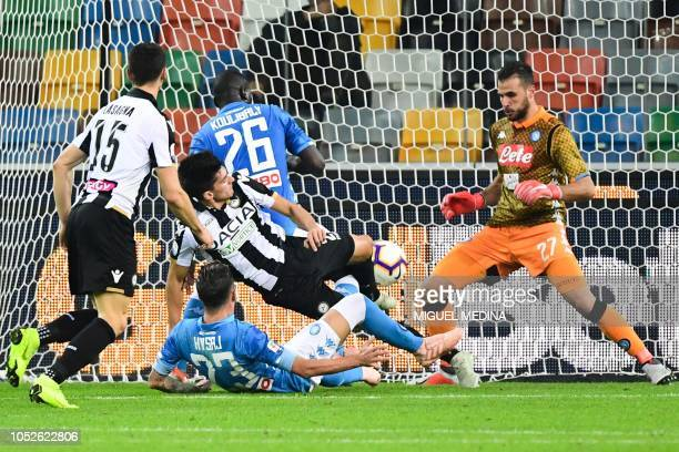 Udinese's Argentine forward Ignacio Pussetto challenges Napoli's Greek goalkeeper Orestis Karlezis during the Italian Serie A football match Udinese...