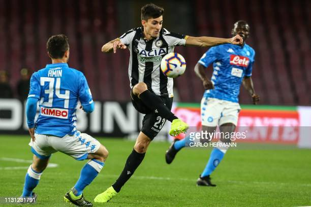 Udinese's Argentine forward Ignacio Pussetto controls the ball during the Italian Serie A football match Napoli vs Udinese at the San Paolo stadium...
