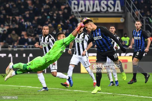 Udinese's Argentine goalkeeper Juan Musso dives to deflect a header from Inter Milan's Argentine forward Lautaro Martinez during the Italian Serie A...