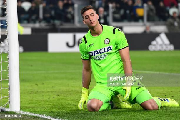 Udinese's Argentine goalkeeper Juan Musso reacts after conceiding a second goal during the Italian Serie A football match Juventus vs Udinese on...