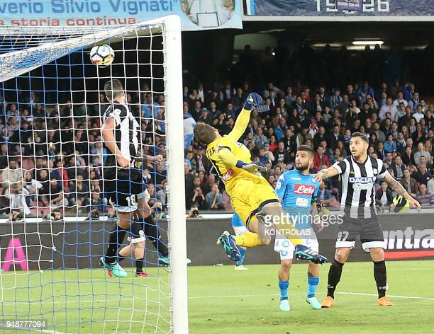 STADIUM NAPLES CAMPANIA ITALY Udinese's Argentinian goalkeeper Albano Bizzarri dives as the ball enters the gate next to Udinese's Italian defender...
