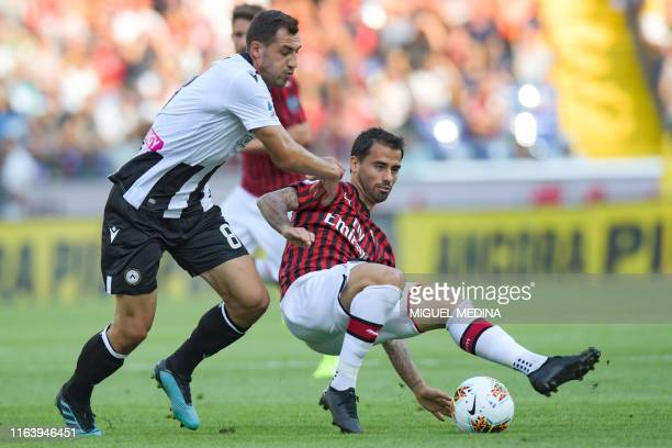 Udinese's Bosnian midfielder Mato Jajalo and AC Milan's Spanish forward Suso go for the ball during the Italian Serie A football match Udinese vs AC...