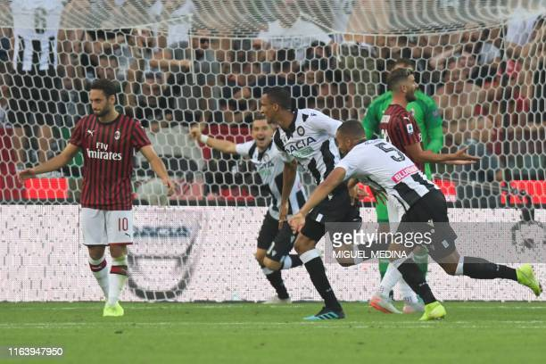 Udinese's Brazilian defender Rodrigo Becao celebrates after scoring during the Italian Serie A football match Udinese vs AC Milan on August 25 2019...