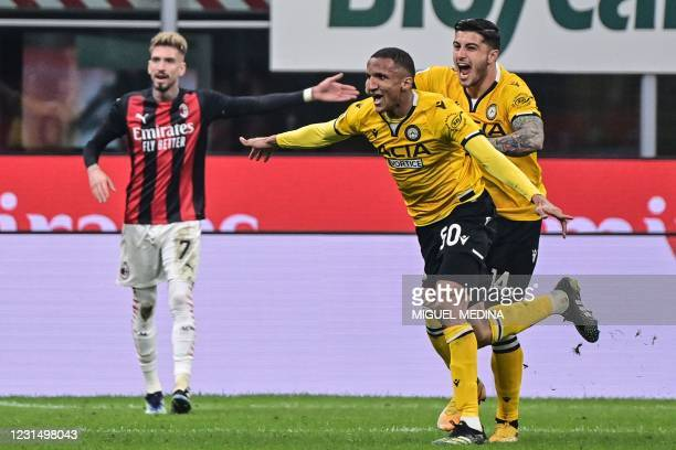 Udinese's Brazilian defender Rodrigo celebrates after opening the scoring during the Italian Serie A football match AC Milan vs Udinese on March 03,...