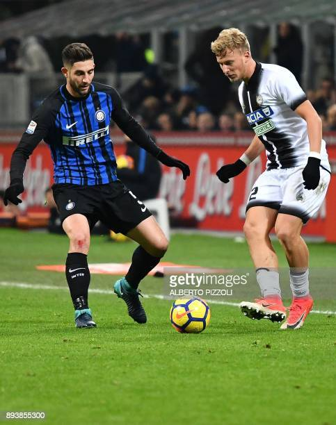 Udinese's Czech midfielder Antonin Barak fights for the ball with Inter Milan's midfielder Roberto Gagliardini during the Italian Serie A football...