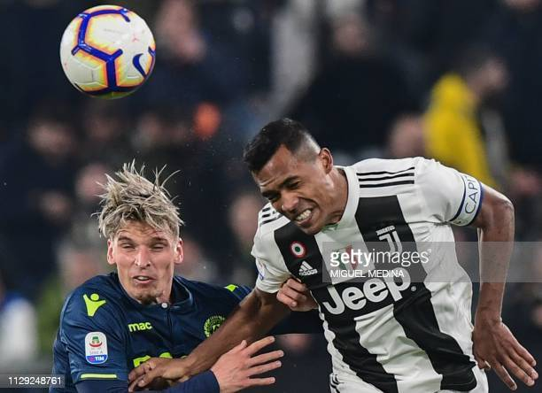 Udinese's Danish defender Jens Stryger Larsen and Juventus' Brazilian defender Alex Sandro go for a header during the Italian Serie A football match...