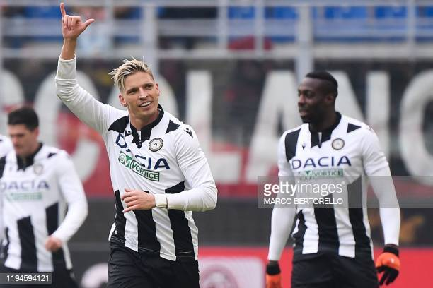 Udinese's Danish defender Jens Stryger Larsen celebrates after opening the scoring during the Italian Serie A football match AC Milan vs Udinese on...