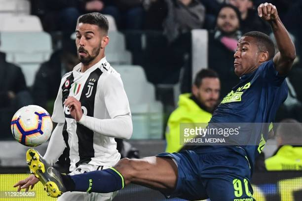 Udinese's Dutch midfielder Marvin Zeegelaar tackles Juventus' Italian defender Leonardo Spinazzola during the Italian Serie A football match Juventus...
