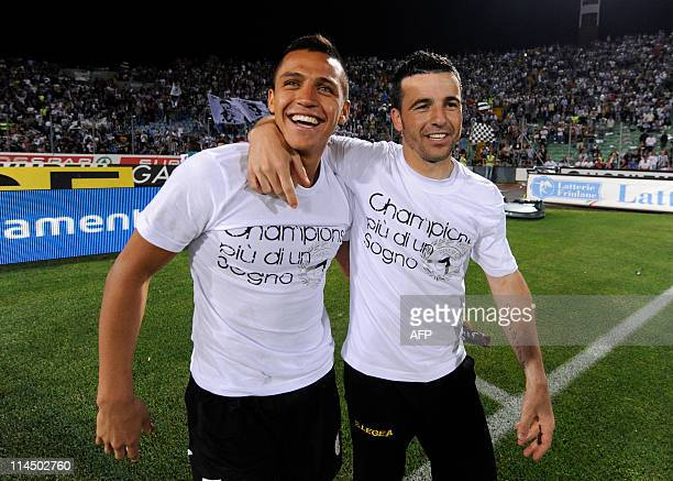 Udinese's forward Alexis Sanchez and Udinese's forward Antonio Di Natale celebrate after the Italian Serie A football match between Udinese and AC...