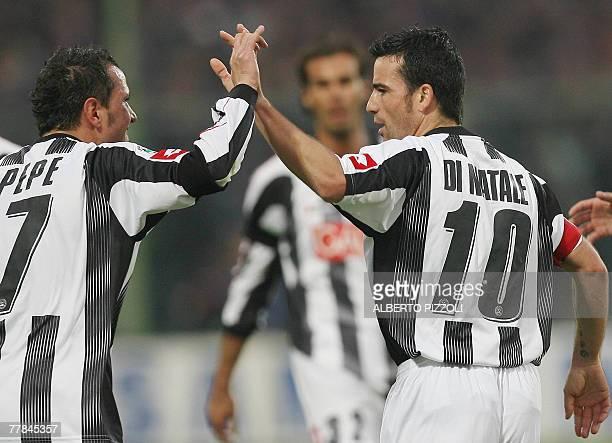 Udinese's forward Antonio Di Natale celebrates his goal against Fiorentina with teammate Udinese's forward Simone Pepe during Fiorentina vs Udinese...
