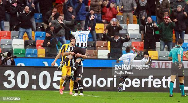 Udinese's forward Antonio Di Natale celebrates wit Udinese's defender Ali Adnan Kadhim after goal by Udinese's midfielder Emmanuel Agyemang Badu 10...